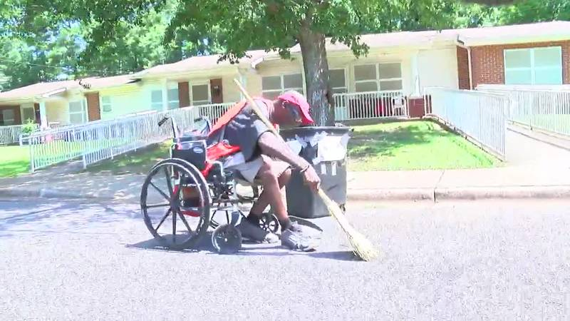 Clover Moore helps clean up Harris Holmes Apartments from his wheelchair