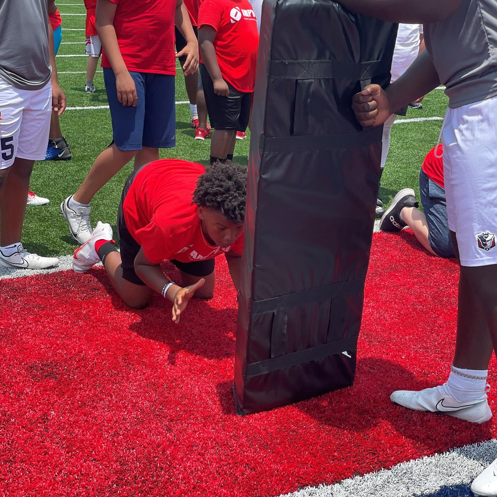 Players of all ages spent the day learning from NFL  players from Central Alabama.