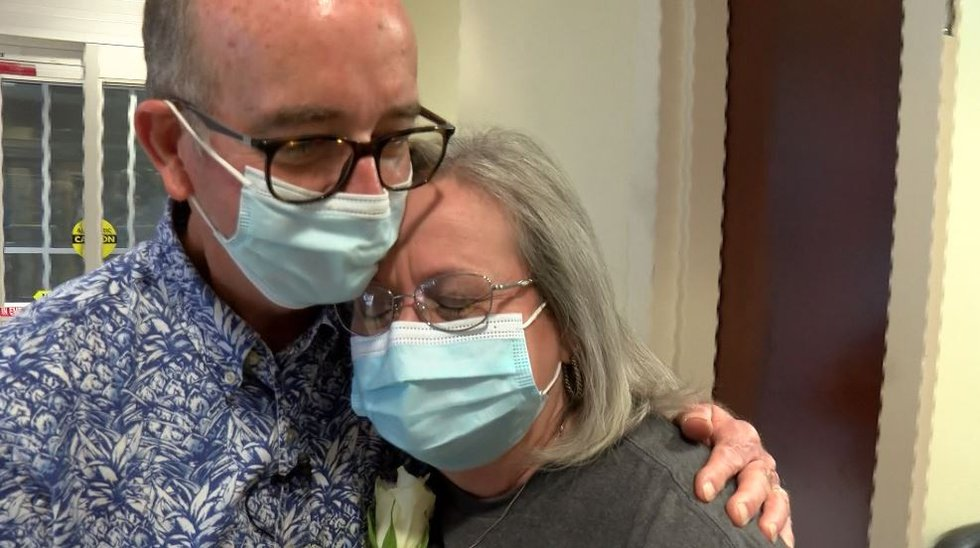 Debbie Skipper kisses Alan Cotton after receiving his first COVID-19 vaccine.