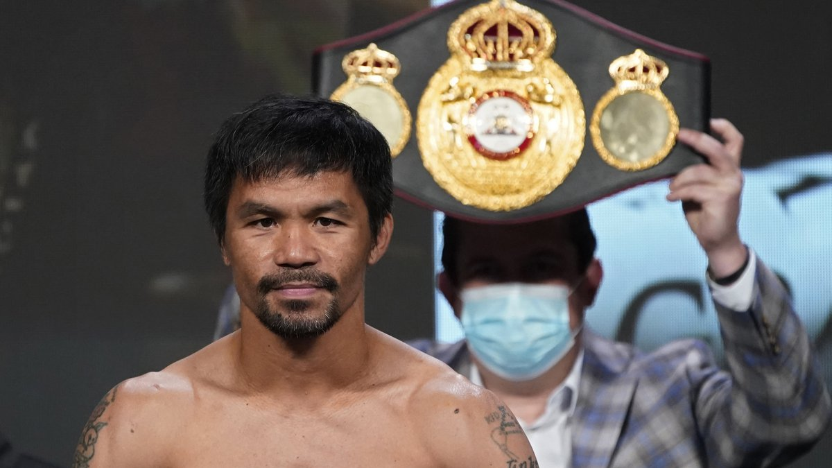 In this Aug. 20, 2021, file photo, Manny Pacquiao, of the Philippines, poses for photographers...