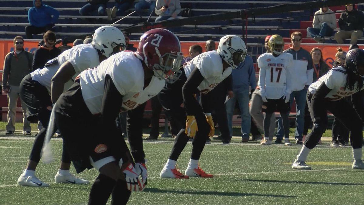 Former University of Alabama defensive back Jared Mayden (front) takes reps at Senior Bowl...