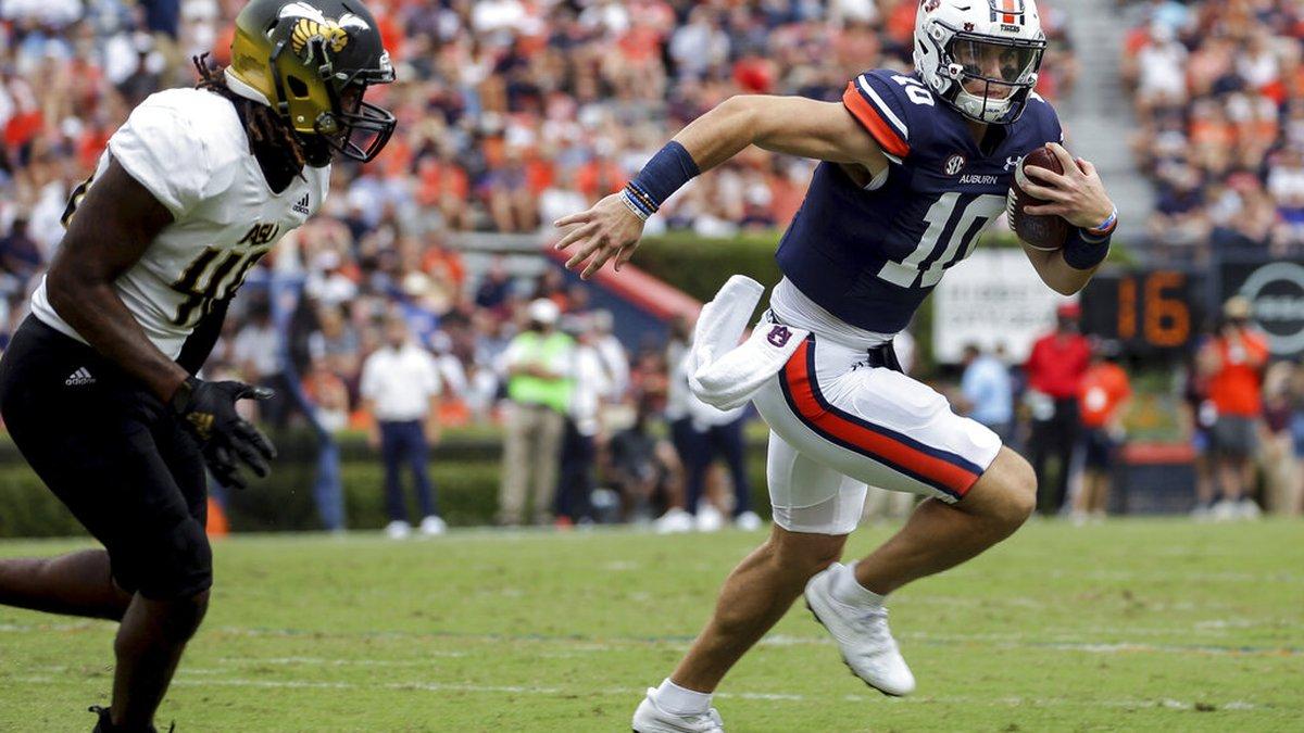 Auburn quarterback Bo Nix (10) carries the ball as Alabama State linebacker Jake Howard (46)...