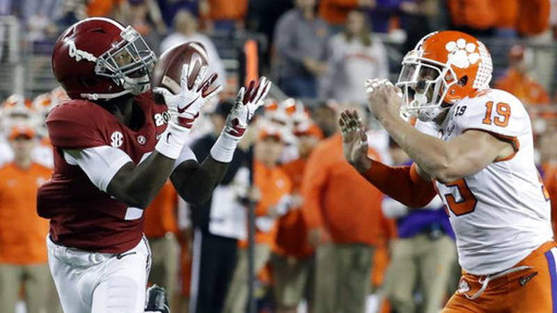 Alabama's Jerry Jeudy catches a touchdown pass in front of Clemson's Tanner Muse during the...