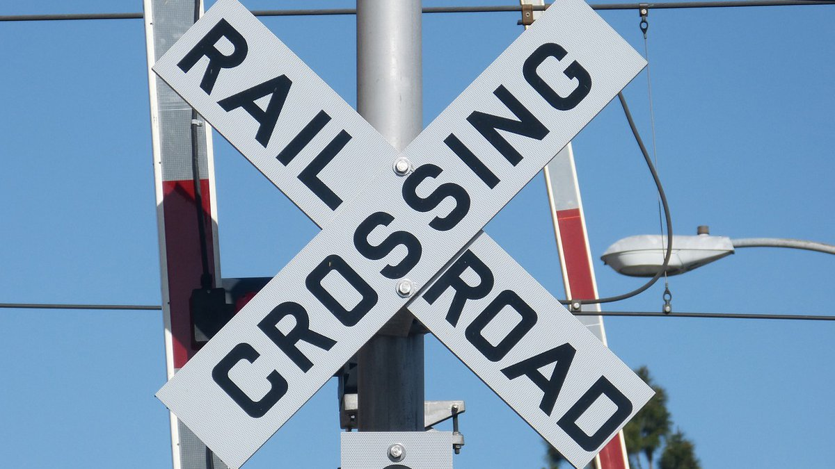 The driver was making a U-turn at a railroad crossing and got stuck. (Source: file photo)