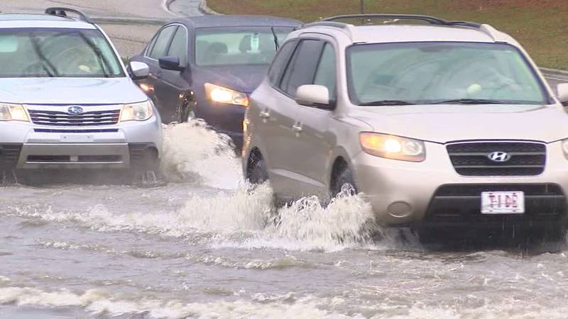 Motorists drive through water on Highway 31 in Homewood Thursday.