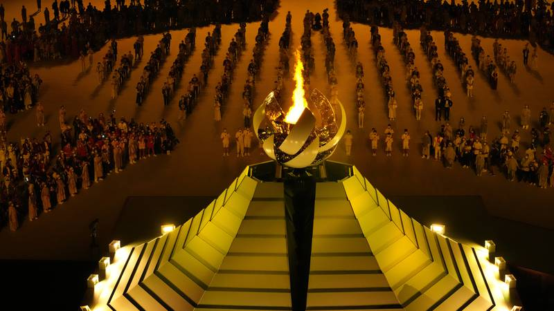 The Olympic flame burns during the opening ceremony in the Olympic Stadium at the 2020 Summer...