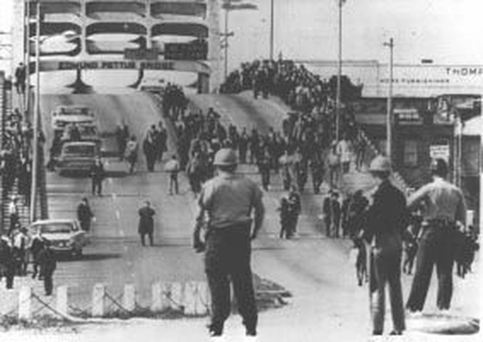 """Civil Rights marchers were met at the base of the Edmund Pettus Bridge on """"Bloody Sunday"""" March..."""