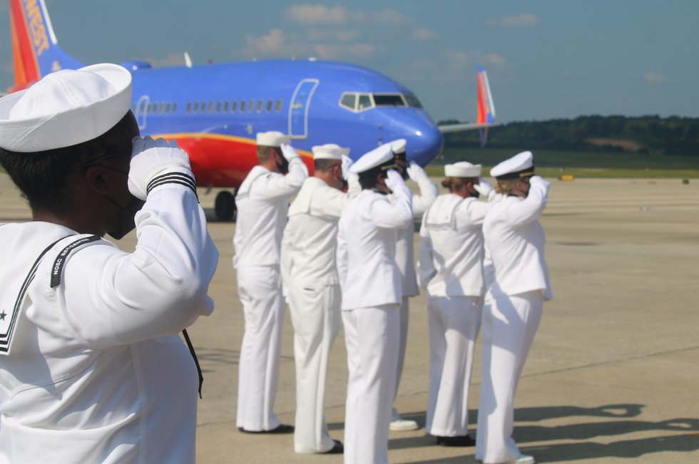A solemn ceremony at Birmingham Shuttlesworth International Airport on Tuesday as the remains of a ...