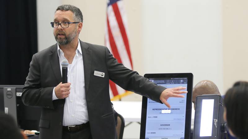 FILE - In this Aug. 30, 2018 file photo, Eric Coomer from Dominion Voting Systems demonstrates...