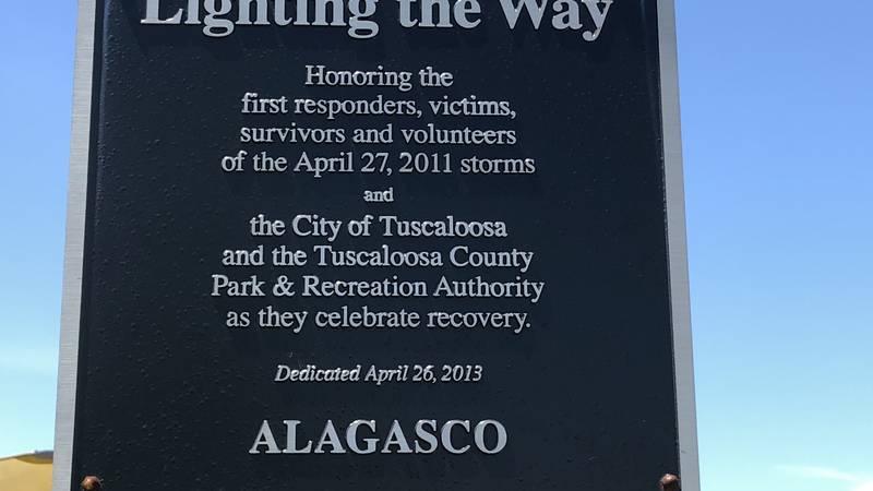 The sign at a tornado memorial at Jaycee Park in Tuscaloosa