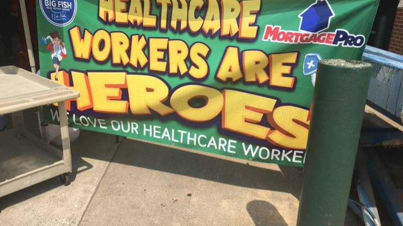 Hundreds of Russell Medical Center personnel enjoy their free lunch courtesy of Mortgage Pro...