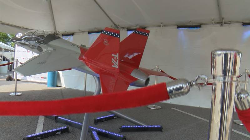 """The T-7A Red Hawk model was on display at the pre-game """"Fan Fest."""""""