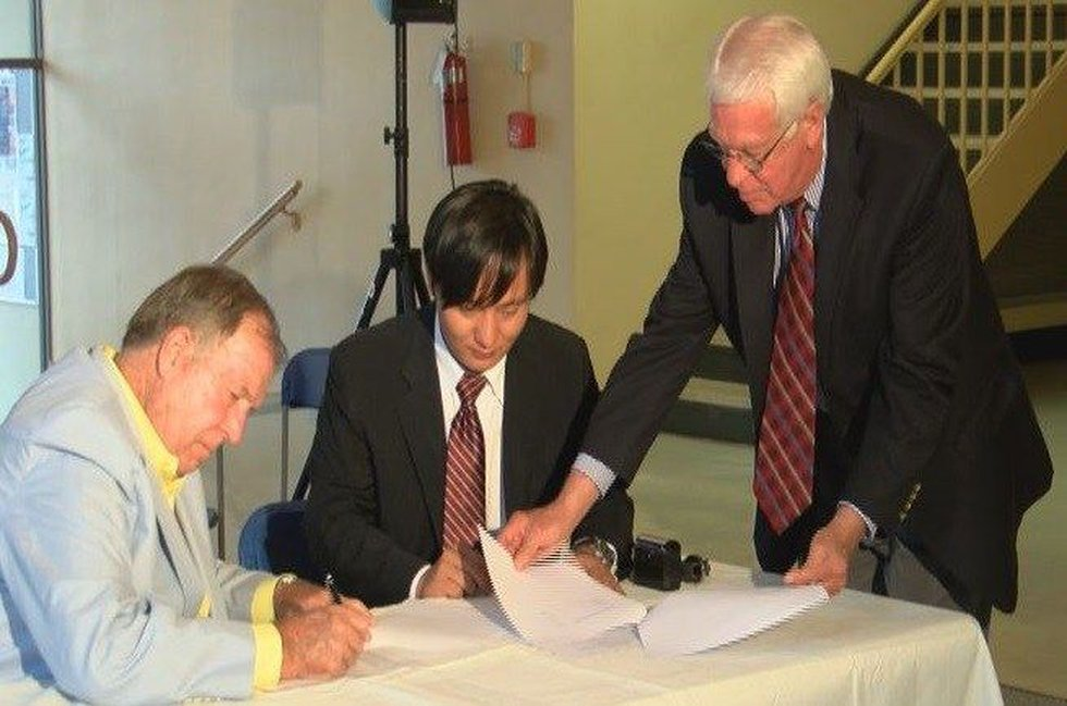 Korens Inc. President signing official paperwork with local officials (Source: WSFA 12 News)