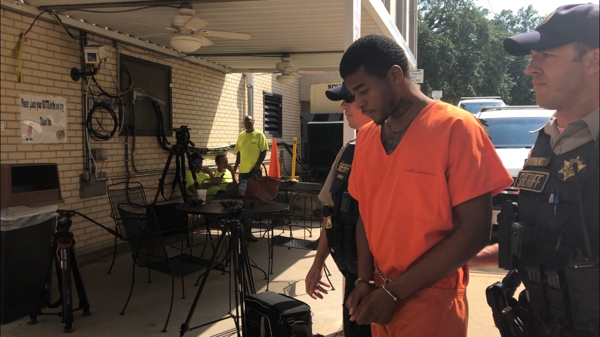 Tuscaloosa County Sheriff's deputies escort Luther Watkins to the Tuscaloosa County Courthouse