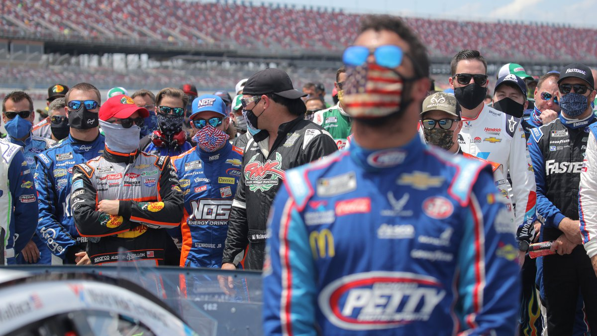 TALLADEGA, ALABAMA - JUNE 22:  NASCAR drivers stand in solidarity with Bubba Wallace, driver of...