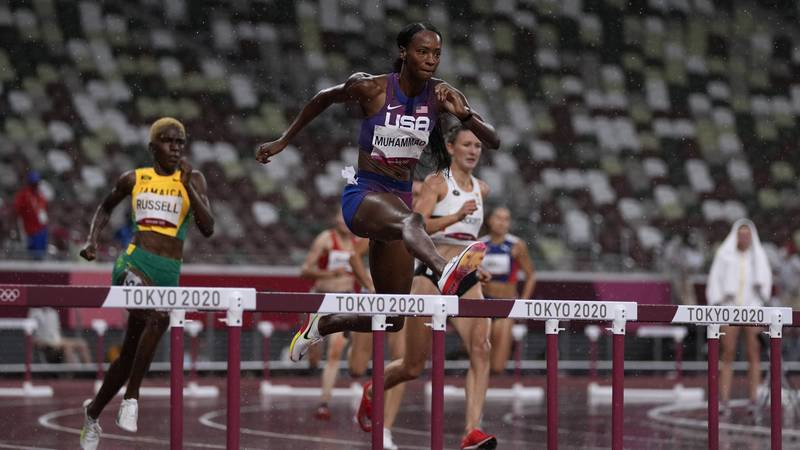 Dalilah Muhammad, of the United States, competes in a semifinal of the women's 400-meter...