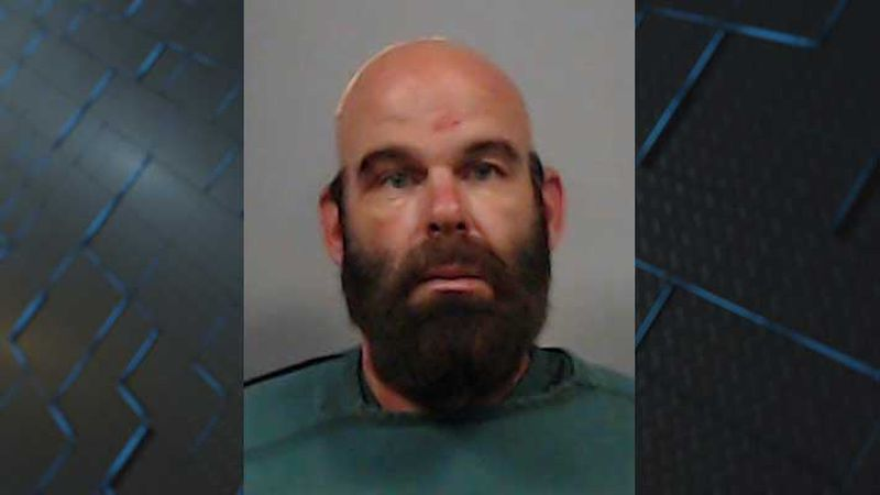 Deputies said Dean Ryan Daugherty fired a gun several times and held a woman against her will...