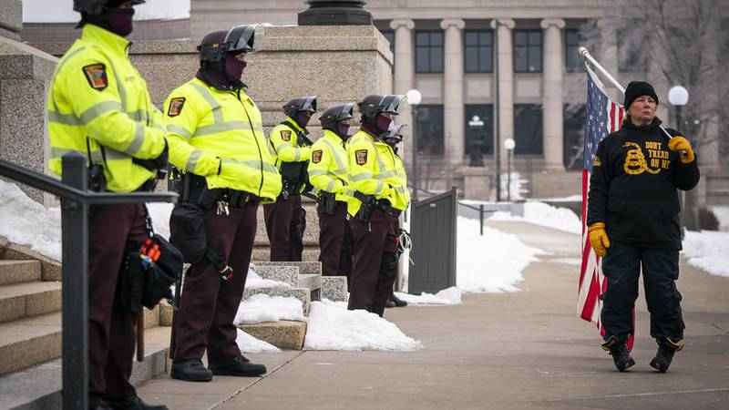 Minnesota State troopers guard the Capitol during a rally supporting President Trump at the...