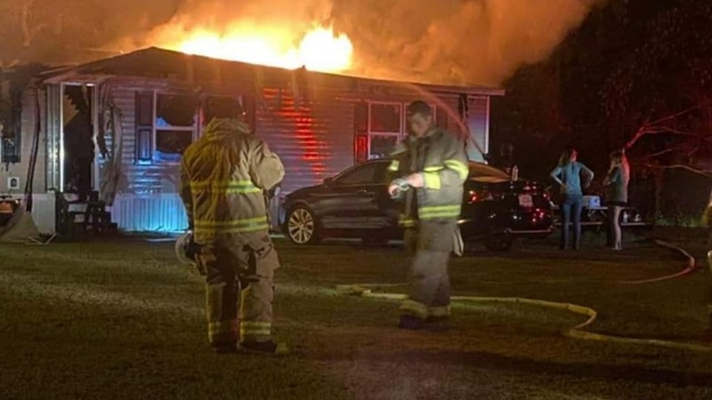 The district attorney says an overnight house fire led to a woman's body being found in her...