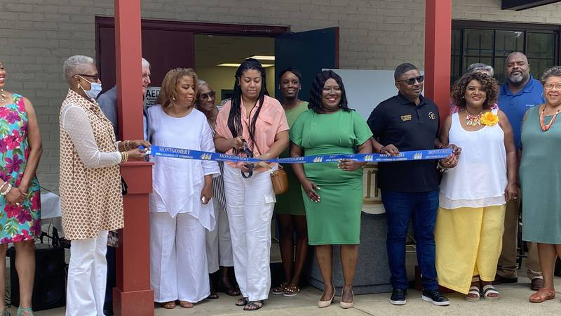 """Family, friends and former colleagues cut the ribbon of the new Hilton """"L"""" Tracy Larkin..."""
