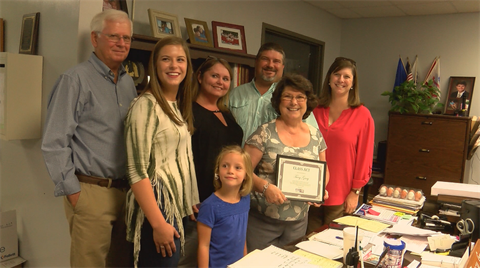 Gray and her family after she wins the Class Act award (Source: WSFA 12 News)