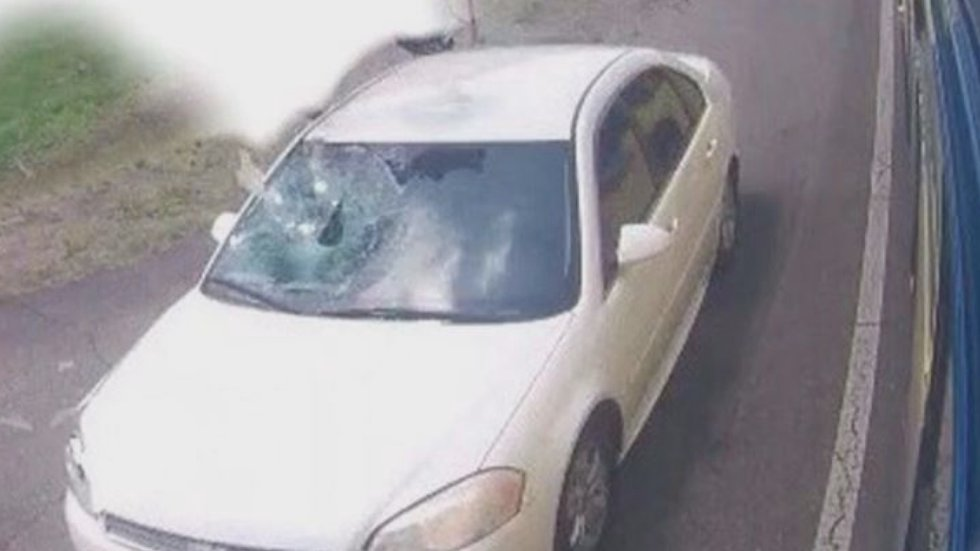 The pictures captured by bus surveillance show the windshield on the passenger side of a white...