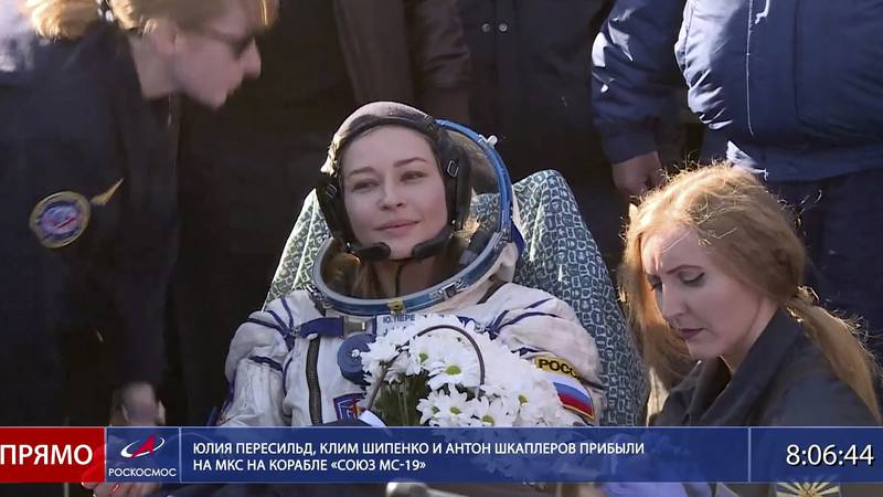 In this photo taken from video footage released by Roscosmos Space Agency, actress Yulia...