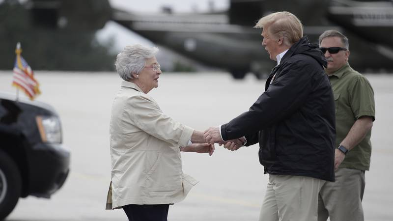 President Donald Trump is greeted by Alabama Gov. Kay Ivey on Trump's arrival, Friday, March 8,...