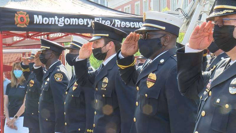 Montgomery Fire/Rescue officials stand in remembrance for those who lost their lives in the...