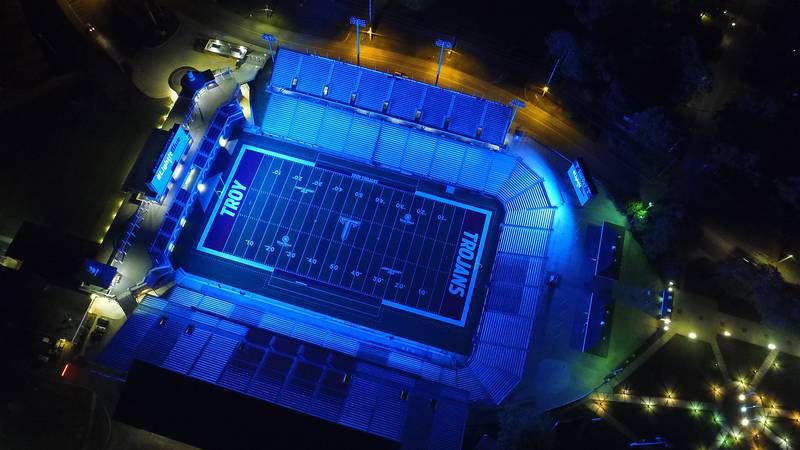 Troy University's Veterans Memorial Stadium is bathed in blue light Thursday as part of the...