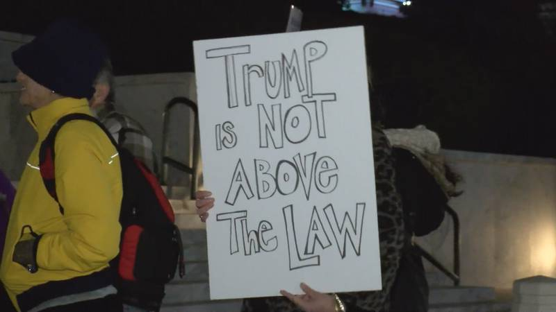 At the rally, protestors urged members of the House to vote in support of impeaching President...