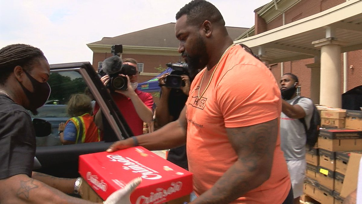 Former Huffman High School football star Marcell Dareus held a food giveaway at Huffman High...