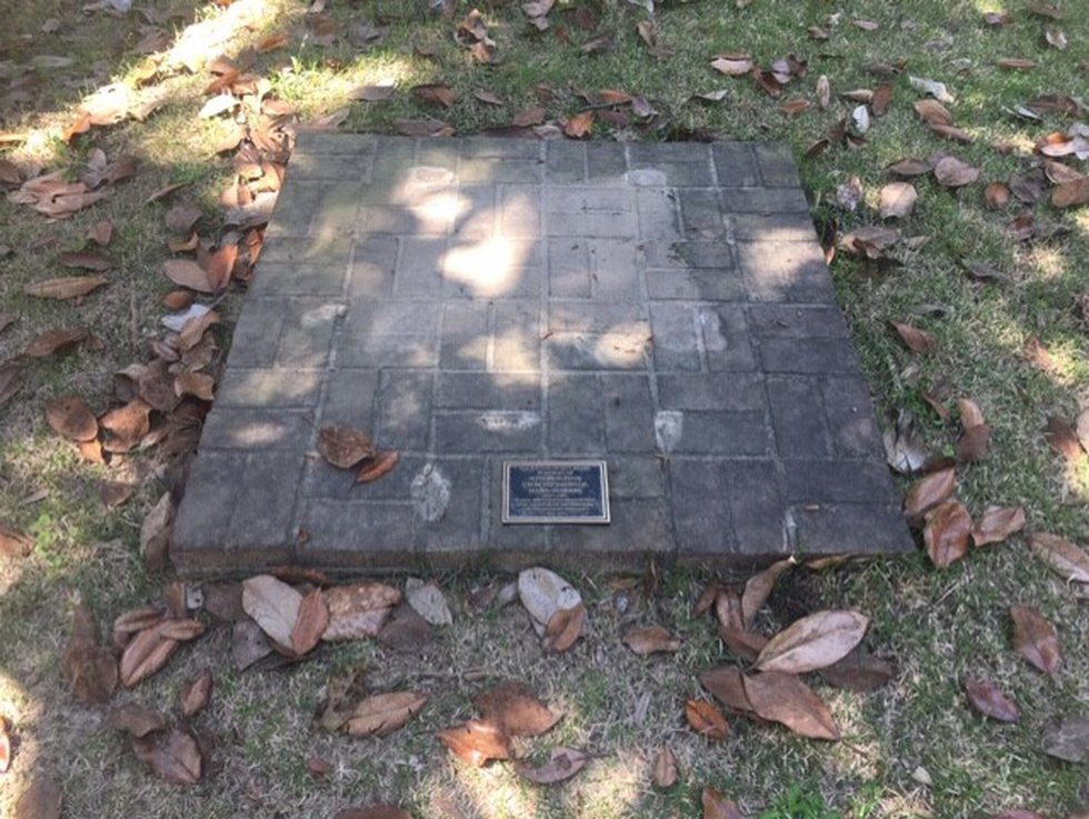 A slab with a historic marker is all that remains inside the Old Live Oak Cemetery in Selma...