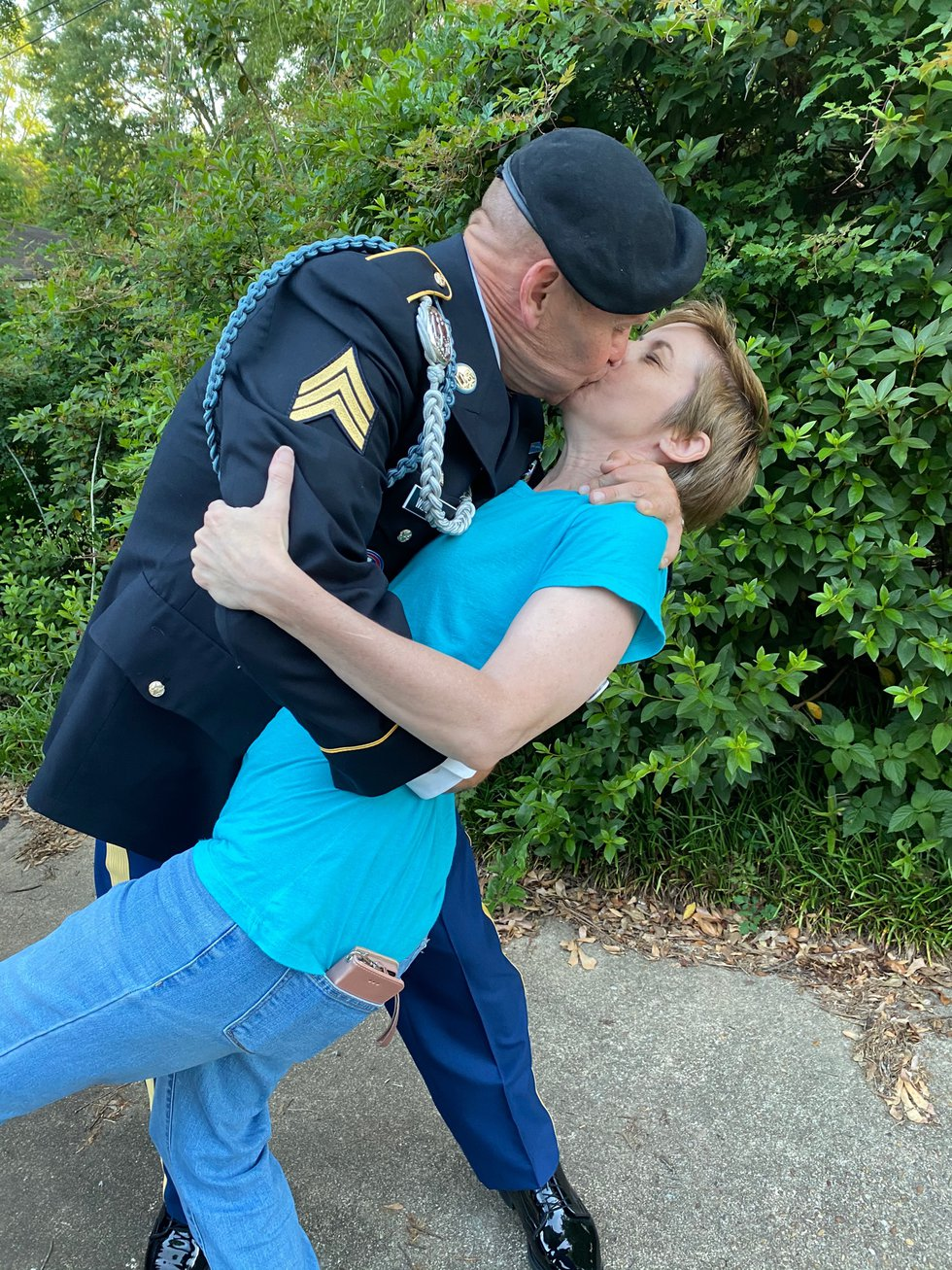 Sgt. Gary Willford Jr., shares a celebratory kiss with his wife after graduating from basic...