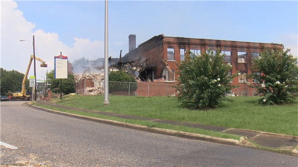 An early morning fire engulfef Booker T. Washington Magnet High School and left the building as...