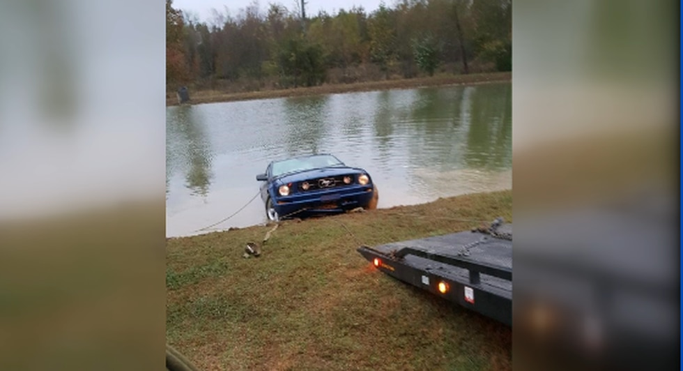 Nearby construction workers pulled a woman from her sinking car in a pond near Elkmont on...