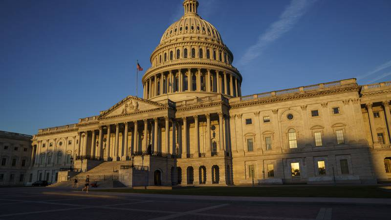 The Capitol is seen at dawn as a consequential week begins in Washington for President Joe...