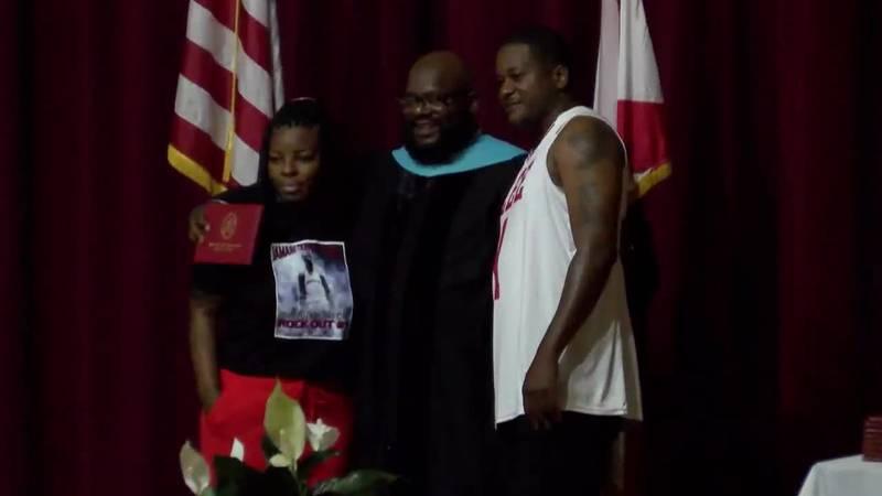 Jamari Smith's parents receive his diploma at Lee HS graduation