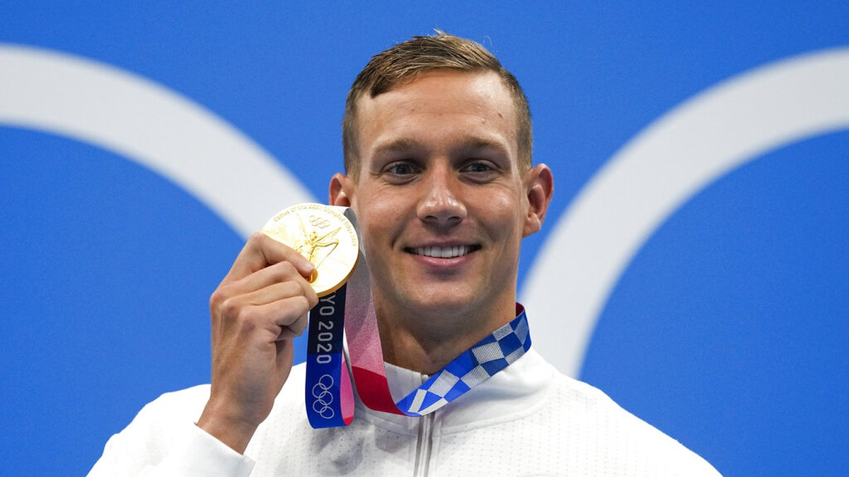 Caeleb Dressel, of United States, poses after winning the gold medal in the men's 50-meter...