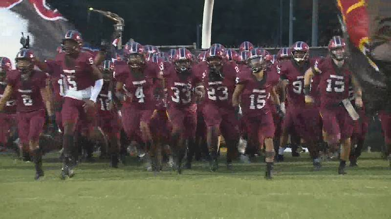 Dothan High Wolves football team runs onto field in this 2020 photo.