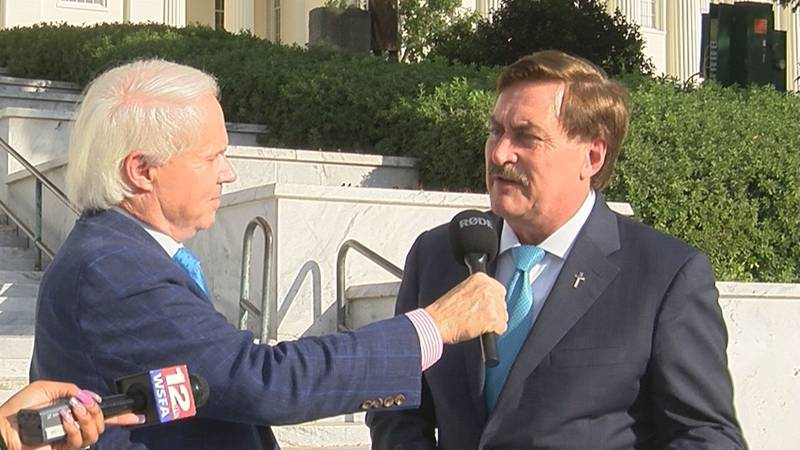 MyPillow CEO Mike Lindell spoke with former state Rep. Perry O. Hooper Jr. outside the Capitol....