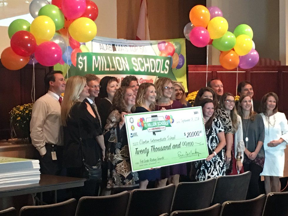 Officials from Clanton Intermediate School in Chilton County collect their $20,000 check for...