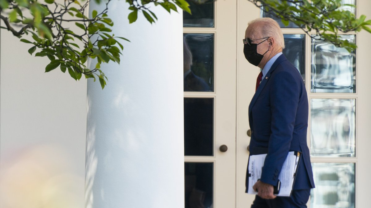 President Joe Biden walks along the Colonnade towards the Oval Office as he returns to the...