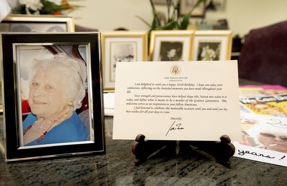A note from President Joe Biden is seen placed among photos of Primetta Giacopini, who died of...