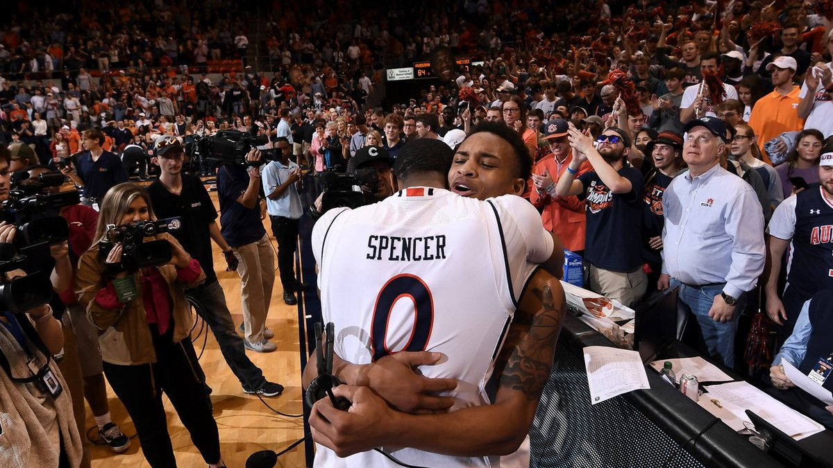 Horace Spencer (0) embraces teammate after Auburn upsets No. 5 Tennessee