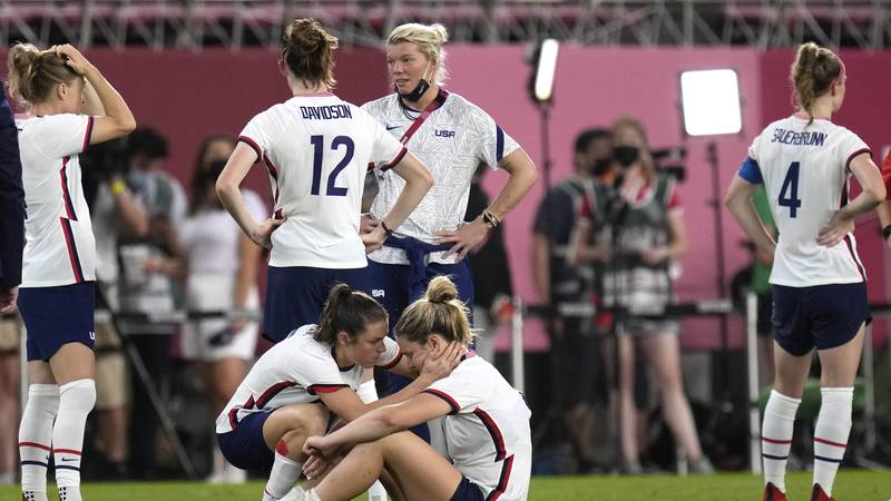 United States' Kelley O'Hara, left, talks to teammate Lindsey Horan after being defeated 1-0 by...