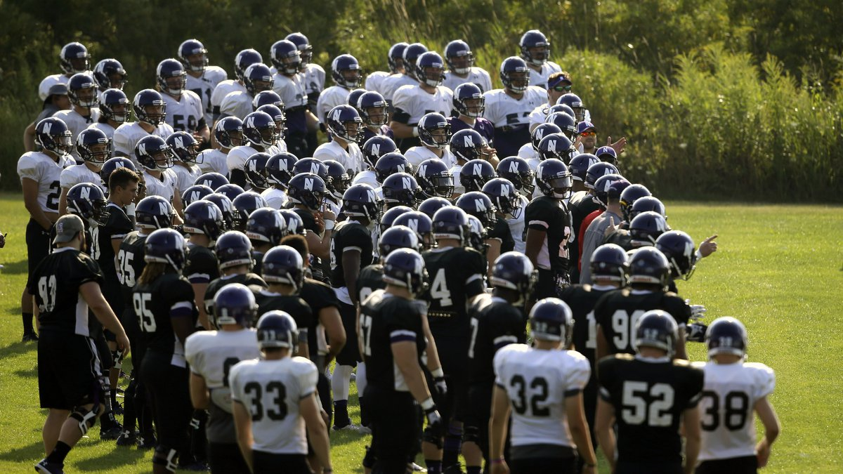 FILE - Northwestern football players gather during practice at the University of...