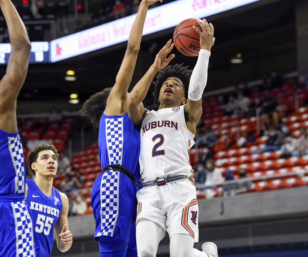 SHARIFE COOPER shoots a basket in the second half Saturday.Auburn v Kentucky MBB on Saturday,...