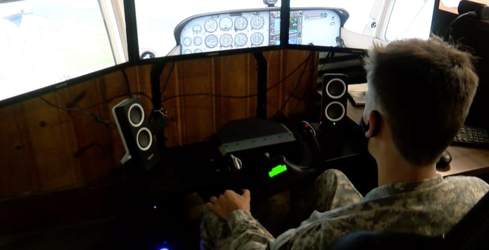 Southern Prep student uses flight simulator on campus.