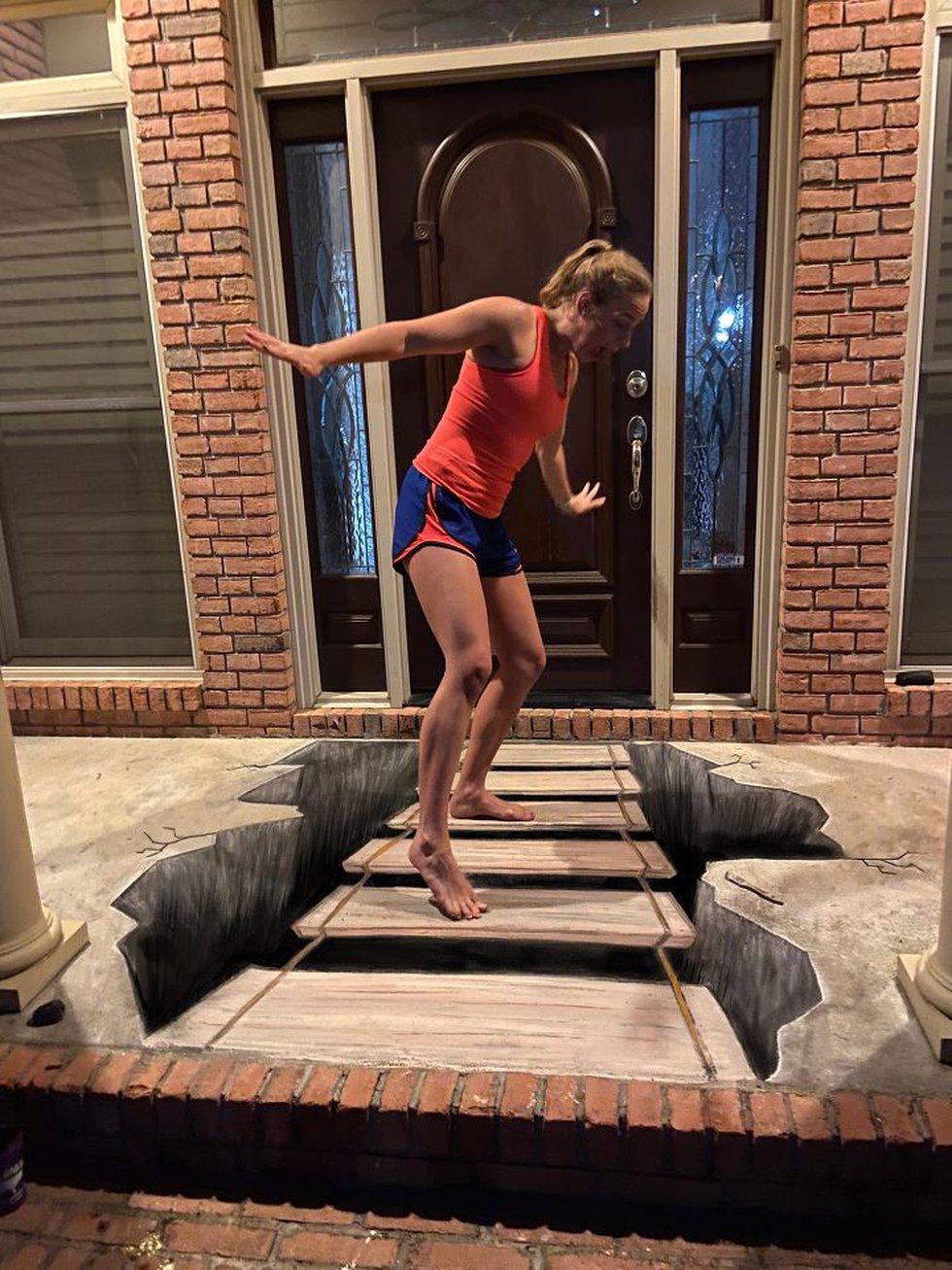 Sarah Dalton Chambliss puts action to the 3D sidewalk art she and her mom, Renée Chambliss,...